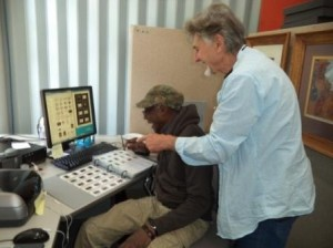 Kivubiro Tabawebbula and Barry Craig Working on the Africa Digitisation Project October 2014